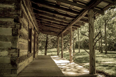 state owned: Appalachian Cabin Lifestyle. Front porch of a historic Appalachian log cabin in the mountains. This is a public building in a state park in Tennessee and is not a privately owned residence.