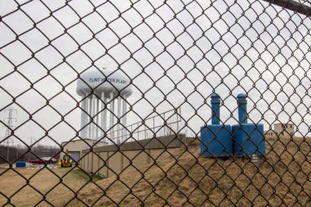 scandal: Flint Michigan Water Tower. Flint, Michigan, USA - February 2, 2016. The exterior of the Flint Water Plant tower. Flint is in the spotlight as concerns over its water quality and lead content have made national headlines. Editorial