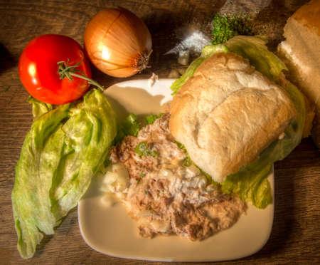 tuna salad: Tuna Salad Sandwich. Tuna salad sandwich on homemade bread with fresh tuna salad, lettuce, tomato, onion, garlic powder and parsley. Stock Photo