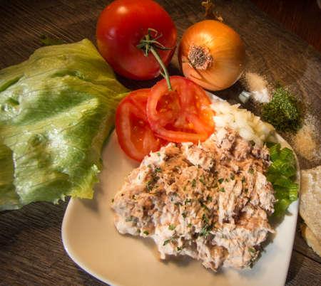 tuna salad: Fresh Chilled Tuna Sandwich. Fresh chilled tuna salad garnished with tomatoes, onions and lettuce with garlic salt and parsley.