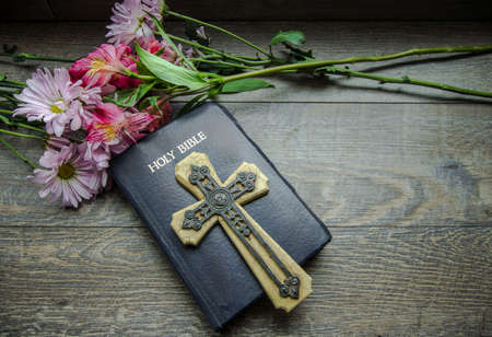 king james: Christian Easter Holiday Background. Bouquet of spring flowers frame a King James Bible with a crucifix. Stock Photo