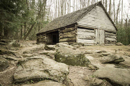 pioneer: Pioneer Homestead. Historical wooden barn on display in the Great Smoky Mountains National Park on the Roaring Fork Motor Nature Trail. Gatlinburg, Tennessee. Stock Photo