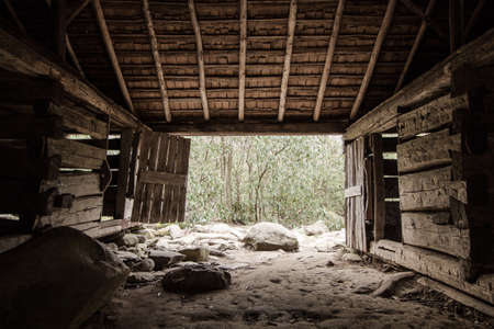 simple life: The Simple Life. Interior of pioneer barn located on the Roaring Fork Motor Nature Trail in the Great Smoky Mountains. This is a historical building in a national park. It is not a privately owned residence or property.