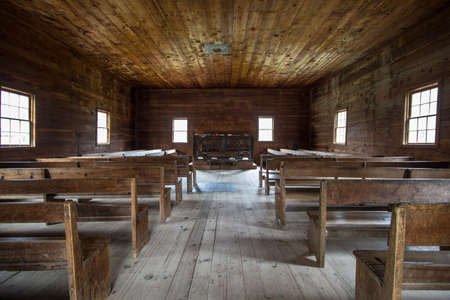 not open: Historical Smoky Mountain Baptist Church. Interior of the historical Cades Cove Primitive Baptist Church in the Great Smoky Mountains National Park. This is a historical display open to the public in a national park, it is not a privately owned property Editorial