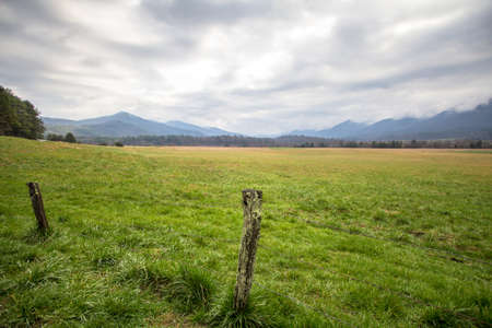 great smoky mountains: Cades Cove Panorama Landscape. Smoky Mountain horizon of the Cades Cove Valley in the Great Smoky Mountains National Park in Gatlinburg, Tennessee.