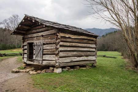 pioneer: Pioneer Barn In Cades Cove. 18th century pioneer barn in the Cades Cove area of the Great Smoky Mountains National Park. Gatlinburg, Tennessee. This is a public display in a national park and not private property. Stock Photo