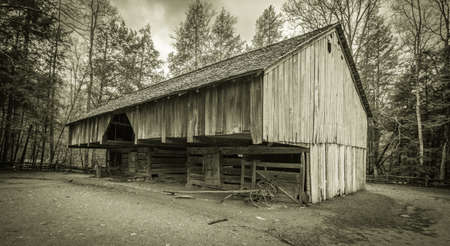 settler: Down On The Farm. 18th century pioneer barn in the Cades Cove area of the Great Smoky Mountains National Park. Gatlinburg, Tennessee. This is a public display in a national park and not private property. Editorial