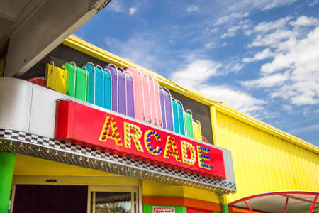 forge: Pigeon Forge Tennessee, USA. March 26, 2016 - Exterior of an arcade with neon sign in the resort town of Pigeon Forge, Tennessee.