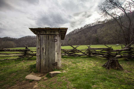 latrine: Wooden Outhouse. Wooden outhouse on display in the Great Smoky Mountains National Park. Stock Photo