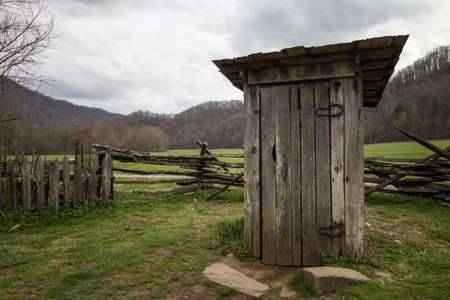 outbuilding: Wooden Outhouse. Wooden outhouse on display in the Great Smoky Mountains National Park. Stock Photo