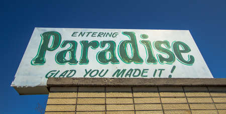 Paradise, Michigan, USA - May 7, 2016: Welcome sign for the small village of Paradise, Michigan. This small town lies on the shores of Lake Superior and has an approximate population of 500. Editorial