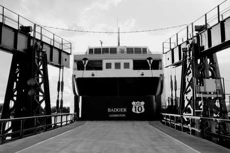 ss: Ludington, Michigan, USA - October 19, 2013: Stern of the SS Badger auto ferry at its home port of Ludington, Michigan. The SS Badger was launched in 1952.