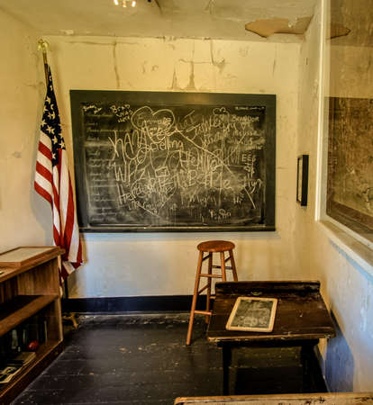old flag: Abandoned One Room Schoolhouse. Fayettte, Michigan, USA - June 13, 2016: A one room abandoned schoolhouse classroom in the ghost town of Fayette, Michigan; located in Fayette State Historical Park. Editorial