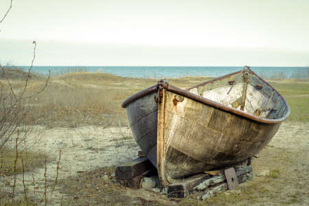 beached: Rusty Boat On The Shore. Rusted boat on the remote coast of Lake Huron. Stock Photo