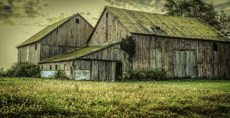 midwest: Midwest America Barn. Weathered and worn early 1900s style barn in horizontal orientation.
