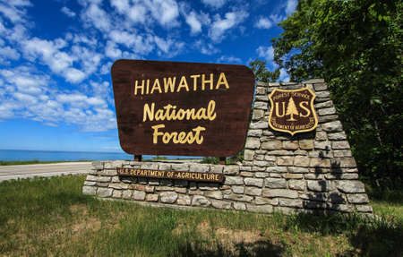 Brevort, Michigan, USA - June 21, 2016: Entrance sign to the Hiawatha National Forest. Hiawatha has coastline on three of the Great Lakes, six lighthouses and thousands of acres of forest.