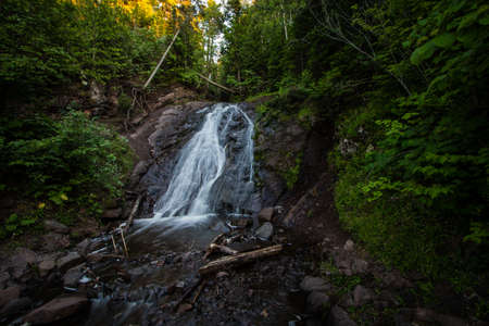 eagle falls: Jacobs Falls In Northern Michigan. Jacobs Falls is in the Keweenaw of Michigans Upper Peninsula outside the small town of Eagle Harbor. The falls is easily accessible along M-26 and is view able from the road. Stock Photo