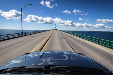 Driving Across Mackinaw. Driving across the Mackinac Bridge in Michigan. The Mackinaw Bridge connects Michigans Upper and Lower Peninsula. It is the largest suspension bridge in the Western Hemisphere. The bridge is part of Interstate 75.
