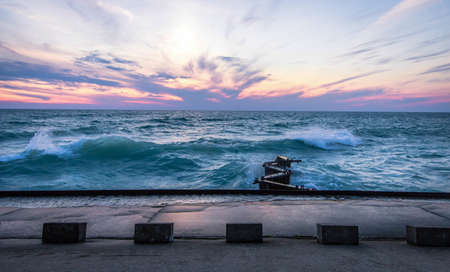 gale: Waves And Lake Michigan Sunset. The sunset over the coast of the Lake Michigan horizon during a gale warning. Lake Michigan is the third largest of the Great Lakes.