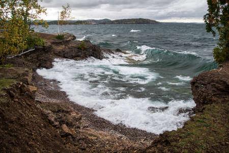 marquette: Lake Superior Coast. The shore of Lake Superior as waves crash on the beach. Presque Isle Park. Marquette, Michigan.
