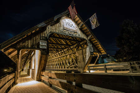 local landmark: Frankenmuth Wooden Covered Bridge.  Covered bridge in the town of Frankenmuth, Michigan. The local landmark spans the Cass River and is open to auto traffic.