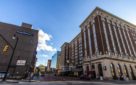 monroe: Grand Rapids, Michigan, USA - September 17, 2016: Monroe Street in downtown Grand Rapids with the historical Amway Grand Plaza Hotel in the foreground. Grand Rapids is one of  the largest cities in Michigan, second only to Detroit.