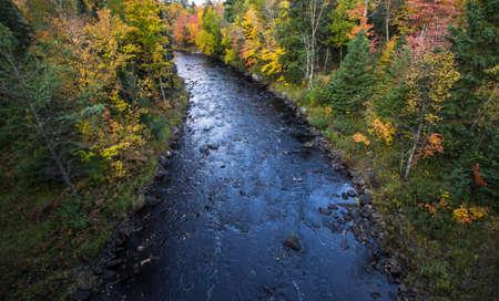 sturgeon: Michigan Sturgeon River Wilderness. The Sturgeon River winds through the wilderness of Michigans Upper Peninsula during the fall foliage of October.