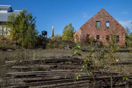 abandoned factory: Calumet, Michigan, USA - July 21,2016: The abandoned mine is part of the Keweenaw National Historic Park in the Upper Peninsula of Michigan. The sites focus on the history of copper mining. Quincy Copper Mine. Calumet, Michigan