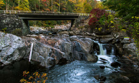 trip over: Great Smoky Mountains Road Trip. Bridge over the roadside Sinks waterfall on Little River Road in the Great Smoky Mountains National Park. Gatlinburg, Tennessee. Stock Photo