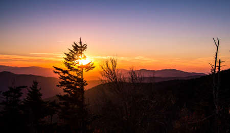 Smoky Mountain Sunset. Smoky Mountain Sunset. Sunset from Clingmans Dome overlook of the Great Smoky Mountains National Park. The Smokies are Americas most visited national park surpassing even Yellowstone and Yosemite.