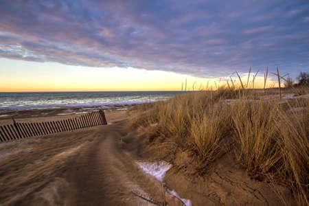 michigan snow: Winter Sunset On The Great Lakes Coast.  Sunset horizon on the windswept shore of the Lake Huron coast in Port Austin, Michigan.