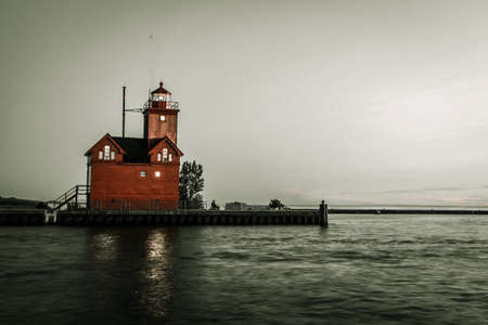 lake michigan lighthouse: Vintage Lake Michigan Lighthouse.  Lighthouse on the shores of Lake Michigan in the city of Holland. The lighthouse is affectionately known as Big Red. Shot in horizontal orientation with copy space. Holland, Michigan. Foto de archivo
