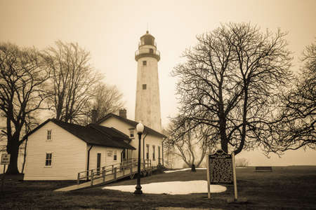 reportedly: Haunted And Historical Michigan Lighthouse.  The reportedly haunted Pt. Aux Barques Lighthouse on the remote shores of Lake Huron in Port Hope, Michigan. Stock Photo