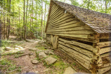 Pioneer Log Cabin. Log cabin in a lush mountain valley in the Great Smoky Mountains National Park. This cabin is a historical display in a national park not a privately owned property or residence.