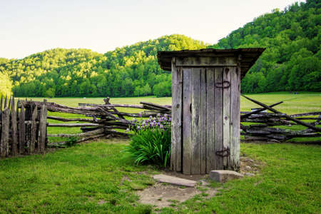 latrine: Backyard Outhouse. Pioneer 1800 style outhouse on display in the Great Smoky Mountain National Park in the Appalachian Mountains.