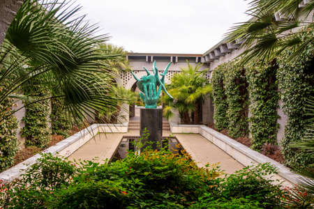 Myrtle Beach, South Carolina, USA - February 23, 2014: Statue and pool at renowned Brookgreen Gardens. Brookgreen is considered one of the premier landscape and sculpture gardens in the United States.