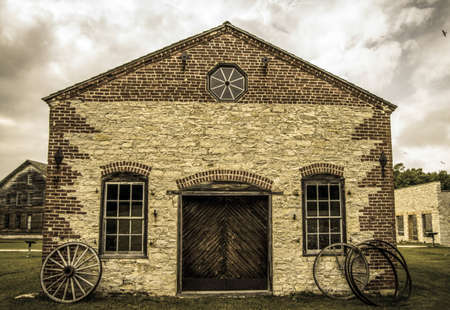 Wagon Wheel Leaning Against A Century Old Stone Wall Fayette.. Stock ...