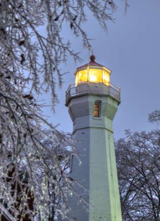 frozen lake: Port Sanilac, Michigan, USA - December 22, 2013: The Port Sanilac Lighthouse along the coast of Lake Huron on a cold winters night.