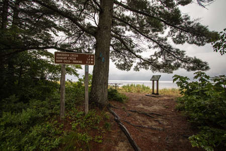 North Country Trail On Lake Superior Coast. Mile marker and blue blaze for the North Country along the Lake Superior coast in the Upper Peninsula of Michigan.
