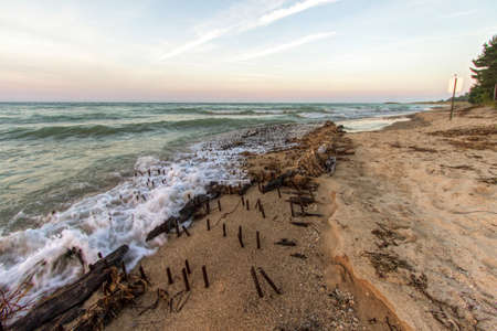 Historic Shipwreck On Great  Lakes Coast. Shipwreck of the ill fated wooden iron ore ship the Joseph S. Fay at Forty Mile Point on the coast of Lake Huron near Rogers City, Michigan.