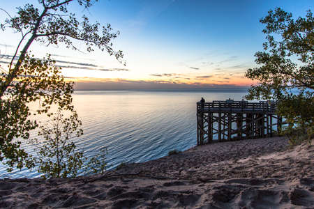 Summer Sunset Over Lake. Massive sand dunes and scenic overlook on Lake Michigan within the Sleeping Bear Dunes National Lakeshore on the Pierce Stocking Scenic Drive in Michigan Stock Photo