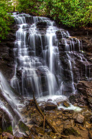 North Carolina Waterfall. Scenic Soco Falls in Maggie Valley, North Carolina in vertical orientation. Stock Photo