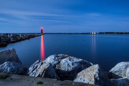 Lighthouse Beacon Background. Illuminated beacon of the Manistique Michigan Lighthouse with copy space.