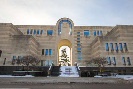 Lansing, Michigan, USA - January 20, 2018: Exterior of the Michigan History Center, state library and archives with a large White Pine tree in the atrium. Stock Photo - 103885509
