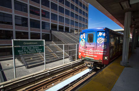 Detroit, Michigan, USA - March 28, 2018: The Detroit People Mover public transit system enters the Bricktown station. The elevated monorail is one of many public modes of transportation in the city. Editorial