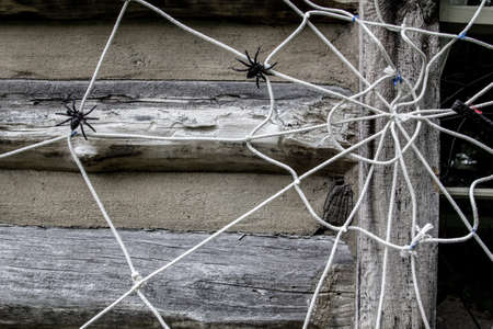 Homemade Do It Yourself Halloween Decoration. Spider web made of old clothesline on exterior of home Imagens