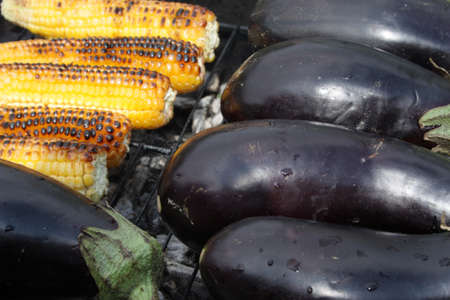 barbecuing: Barbecuing vegetables on charcoal fire closeup image.
