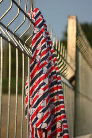 Welded: Welded wire fence with a piece of textile on it. Stock Photo