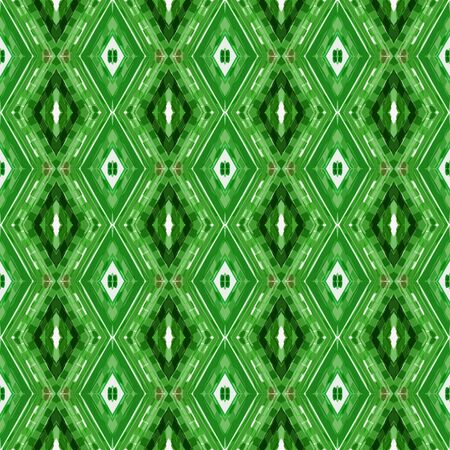repeatable pattern with forest green, beige and pastel green colors. seamless graphic can be used for packaging paper, fabric, wallpaper and textures. Фото со стока
