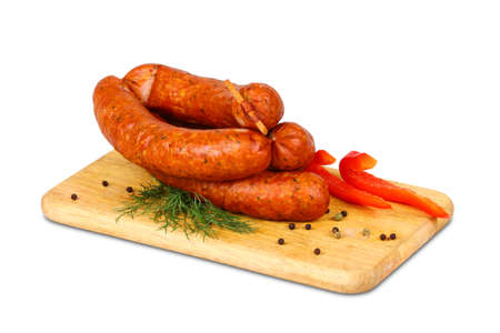 good cholesterol: Sausage on wooden plate with spices Stock Photo